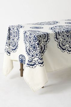 Love this tablecloth, although - I love my rustic butcher's table too much to cover it.