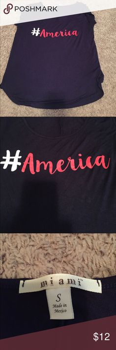 Mi ami #America t-shirt. Navy t-shirt with #America. Very comfortable and stretchy material. Worn twice. Francesca's Collections Tops Tees - Short Sleeve