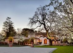 Located in the heart of Atherton, The Bella Sera sits behind her gates surrounded by over 2 ½ acres. The tumbled travertine and cobblestone framed driveway with a center stone from the Vatican streets immediately create an authentic old world experience. The Italian architectural influences and accents continue before entry with the antique tile roof, chimney pots and fountain as you approach the grand entrance.