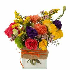 Looks like it was just picked in the garden! Flowers include roses, lysianthus, carnations, waxflower and more. In a stylish cube vase wrapped in burlap ribbon. Burlap Ribbon, Carnations, Floral Arrangements, Floral Wreath, Joy, Vase, Spring, Summer, Flowers