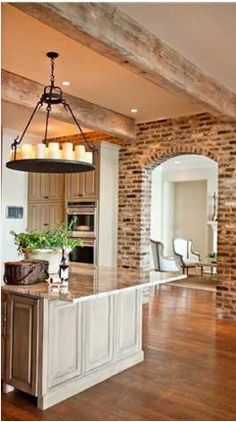 Exposed brick, beams, and arched door ways... My favorite combos.
