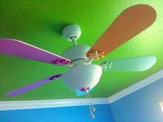 Diy paint your ceiling fan i just painted my fan white ceiling bright painted ocean theme nursery ceiling fan blades in baby colors of lavender purple pink orange mozeypictures Gallery