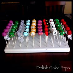 Alice in wonderland cake pops from www.facebook.com/delish.cakepops