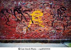 graffiti op baksteen, met geel