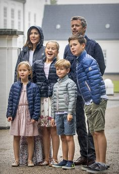 Crown Prince Frederik and wife Crown Princess Mary of Denmark with their children, from right to left Prince Christian, 11, Princess Isabella, 10, and twins Prince Vincent and Princess Josephine, six, donned metallic puffer jackets to keep dry in the summer drizzle. Princesses Isabella and Josephine wearing dresses in understated tones of pink and cream while the two Princes Christian and Vincent keeping cool in the summer heat with shorts.