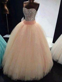 This would be so pretty as a wedding dress. I love the rhinestone top