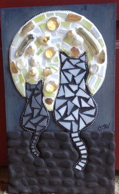 Just finished this one. 'Super Moon'. Mosaic cats watching the full moon. Made from glass beads and gems, polished quartz, mosaic tiles, river rock and ball chain.