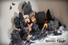 DIY Dollar Store Halloween Village: Spray paint Christmas houses black and viola! A Halloween village. This is such a great idea! Halloween Snacks, Spooky Halloween, Diy Halloween Village, Dollar Store Halloween, Halloween Scene, Easy Halloween Crafts, Dollar Store Christmas, Homemade Halloween, Dollar Store Crafts