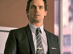 Dolce and Gabbana suit and shirt, Hugo Boss tie, Magnanni shoes, vintage tiebar at Ilene Chazanof NYC- White Collar USA network