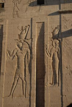 Edfu. Detail of Horus and Hathor on the Pylon. Erected by Ptolemy IX (88-81 BC), the Pylon was one of the last features to be added