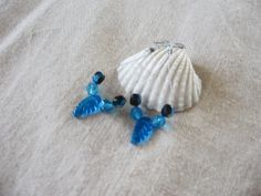 #Leaf earrings #Summer #Blue #reneeoriginals1 #lightweight #jewelry  These earrings are in the hoop style with a blue leaf accent and light blue and reflective beads. These earrings are Hypoallergenic.