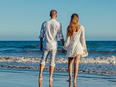 Rear View of Couple on Beach Against Clear Sky, find more Love Photos on LoveIMGs. LoveIMGs is a free Images Pinboard for people to share love images.