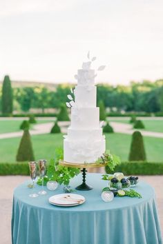 "From the editorial ""Exclusive Château De La Gaude Wedding Inspiration, a Provence Venue Never Seen Before!"" The beautiful wedding cake, designed by Made in Cake, was incredibly delicate and matched the softness of the overall styling. Displayed on a velvet linen, the scene truly gave the impression that this piece of art was preciously floating above the gardens. LBB Photographer: @oliverflyphotography #weddingcake #whitecake #whiteweddingcake #francewedding"