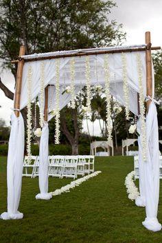 Wedding Arch: Bamboo, tulle, & floral strands / Dmitri & Sandra Photography via CeremonyBlog.com