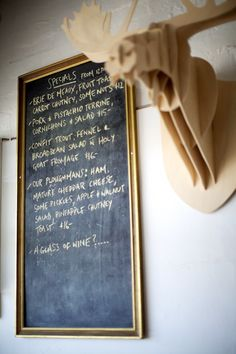 gold frame, gold chalk, menu board, photography by Guy Lavoipierre
