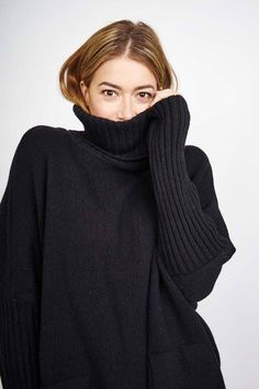 Snuggly batwing jumper cut for a loose, cocooning fit and features a ribbed roll neck, large front pockets and slim sleeves with a ribbed cuff