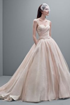 White by Vera Wang blush taffeta ball gown wedding dress with embellished straps and draped tulle detail. Strapless ball gown features eye-catching and opulent