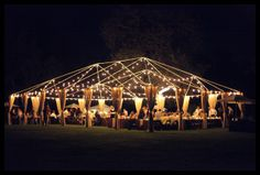 Open tent frame gives structure & character to outdoor space. Simple lighting and burlap draping adds simplistic elegance.