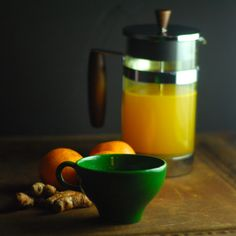 French Press Turmeric Tea Recipe Beverages with shredded coconut, fresh turmeric, fresh ginger, orange zest, ground black pepper
