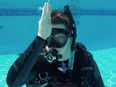 The scuba diving hand signals every diver should know, from out of air to trouble equalizing.