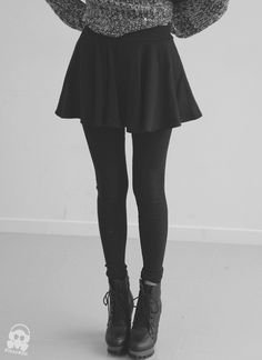Tights, sweater, tulip skirt, and boots.