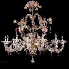 Ca' Rezzonico Barchetta color oro e rubino. Visit  muranolampstore.com