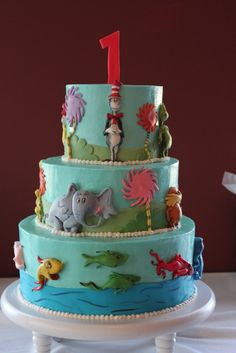 Dr Seuss Birthday Cake. We call the little guys Thing 1 and Thing 2, I see this in their future:)