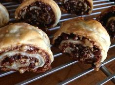 Rugelach is a jewish cookie made with a cream cheese pastry dough, and rolled with brown sugar, nuts, cinnamon, anything else you love (like chocolate!)