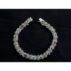 Multi color gemstone bracelet Sterling silver & marcasite multi color gemstone bracelet. 7 1/2 long and 3/8 wide with Blue topaz stone, amethyst, garnet, citrine, peridot stones. Jewelry Bracelets