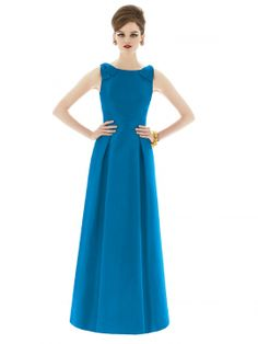 Full length sleeveless peau de soie dress w/ bow detail at shoulder. Bateau neckline w/ v-back. Full pleated skirt w/ pockets at side seams. Also available cocktail length as style D628.