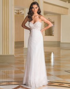 Justin Alexander wedding dresses style 8871 This 1920's inspired gown has a sweetheart neckline, heavily adorned bodice of beaded pearls, opaque Marquee and bugle beads, empire waist, and English net skirt with a chapel length train.
