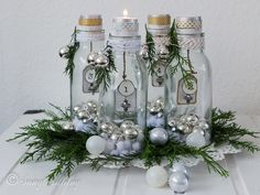 The perfect start to the Christmas season: an Advent candles decoration. Using four bottles, tea lights and tags, this project is easy to make and just beautiful.