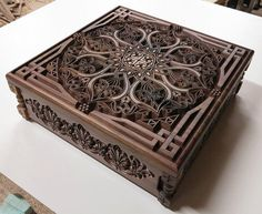 Jewelry box with carved oriental ornaments and motifs made of selected walnut wood (American walnut), inside is upholstered in white velvet. Outside