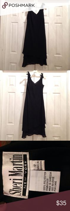 Black Cocktail Dress Simple Black elegant Sheri Martin/New York dress w/ ruffles at the hem & sheer bows on each shoulder. Fully lined. Has an old school, vintage feel to it. In great used condition. Size 12. Sheri Martin/New York Dresses Midi