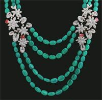 Necklace with green onyx beads, and brilliant cut diamonds with oval tourmalines as accents from Asar