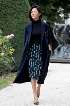 long coat over turtleneck and printed pencil skirt
