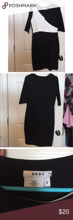 DKNY Colorblock Dress Black & white color block dress from DKNY. size 6. Very flattering fit. White is almost like an off white, not completely white (see close up photo). Great condition. Perfect for the office or a night out ;) Dkny Dresses