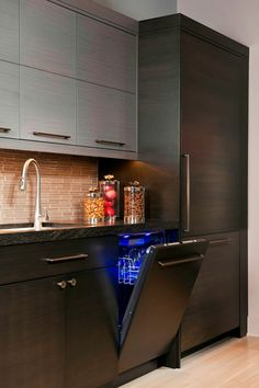 The other appliances, like the dishwasher, are hidden behind facades that match the lower cabinets. The inside of the dishwasher is lit with a brilliant blue light that gives it a futuristic cast. Kitchen Interior, Kitchen Design, Kitchen Ideas, Upper Cabinets, Kitchen Cabinets, London Apartment, Low Cabinet, Private Room, Luxury Interior