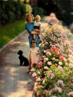 Princess Grace in the garden with her children Albert, 1, and Caroline, 2. Monaco, 1959.