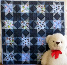 Baby Boy Blue Jeans - a handmade baby quilt made with 100% cotton baby flannel and blue jean fabrics.   FOR SALE $130.00