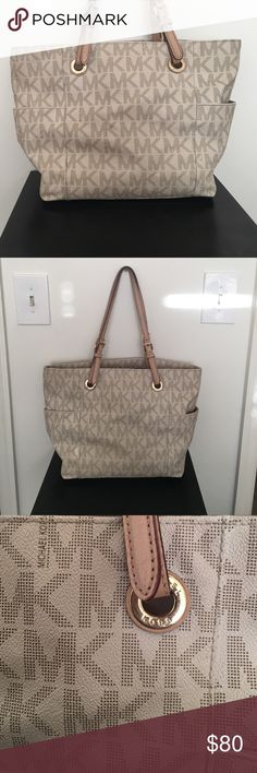 Michael Khors Purse Lightly used Michael Khors purse. Off white, tan and gold. Goes with almost everything! Lindsey Brown Luxe Resort Jackets & Coats Jean Jackets