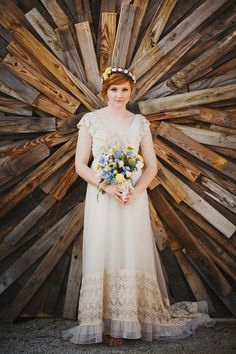 vintage wedding dress and wood pallets wedding backdrop