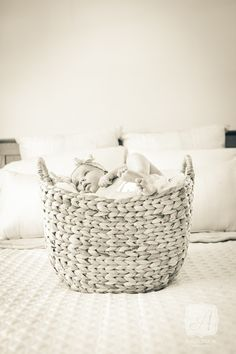 Natural Light Newborn Lifestyle Portrait - Baby Girl in Basket. © Angelina M. Photography, LLC