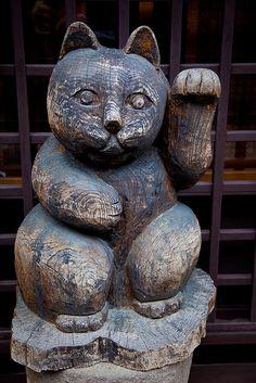 Maneki Neko (Beckoning Cat). Carved Wood. Takayama, Japan.