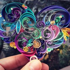 Paper filigree an art form that uses strips of paper that are rolled, shaped, and glued together to create decorative designs.
