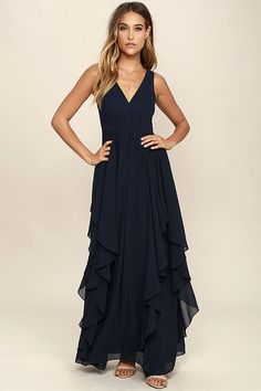 The Simply Sweet Navy Blue Maxi Dress is the dress you've been dreaming of! Lovely chiffon shapes a gathered, princess seamed bodice with a V-neck and back. A banded waist tops a flowy maxi skirt with flaring, ruffled godets. Hidden back zipper.