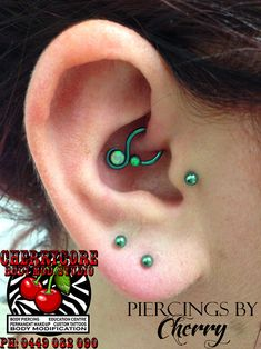 16g daith piercing by Cherry at the Cherrycore Body Mod. Studio in Melbourne, Australia! Jewellery is green niobium daith loop with captive opals by Unbreakable Body Jewelry! Check out www.cherrycorebodymod.com for more work done at the Cherrycore Body Mod. Studio!