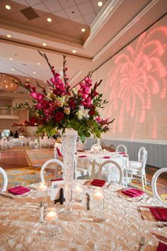 Pink floral arrangements at this reception at Disney's Grand Floridian Resort & Spa