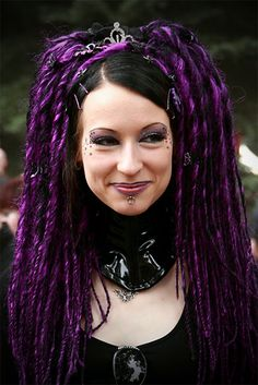 Lovely star work around her eyes, this Cyber Goth girl with purple dreads knows she's a cutie!