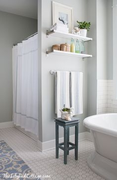 Master Bathroom Decor - The Lilypad Cottage - love the wall shelves and the accents on them.